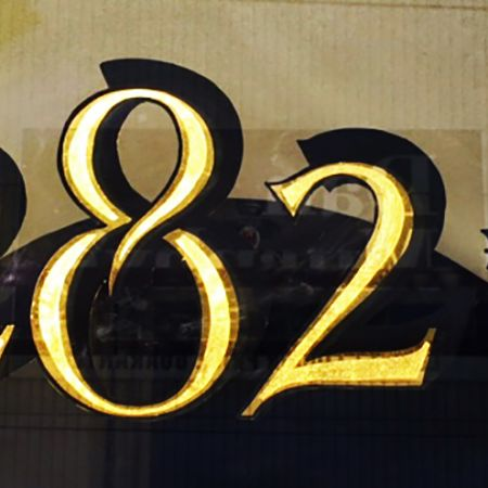 Hand lettered street number on glass using 24ct Gold Leaf Gilding, for 282b Chapel Street.