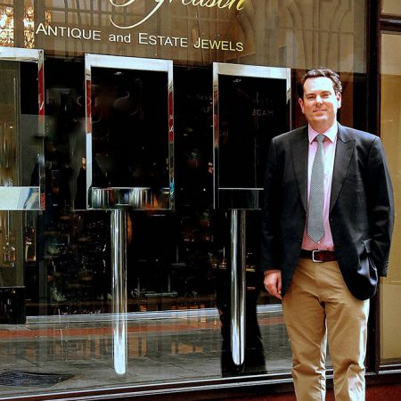 James Alfredson  proud of his Bespoke Hand Written 24 Karat Gold Leaf window sign. <br /> Studio 56 / 26 Howey Pl. Melbourne CBD Victo