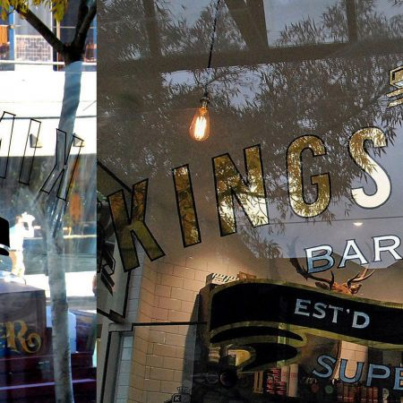 24 karat Gold & Silver leaf gilded sign for Kings Domain, Toorak Rd, South Yarra, Melbourne.<br /> Picture shows Reverse Hand lettered