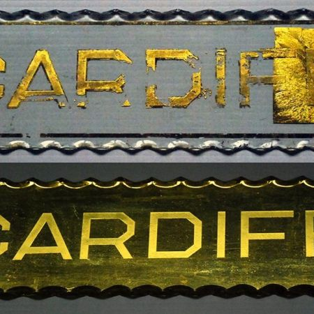 """Cardiff"". Gold Leaf Restoration of Glass Plaque."
